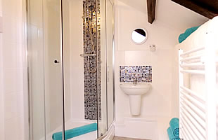 Bathroom with shower cubicle, washbasin and wc