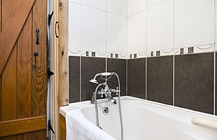 Bathroom with bath and over-bath shower, washbasin and wc
