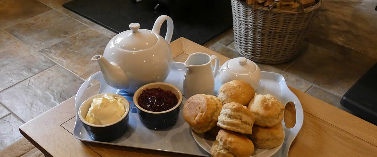 A warm welcome awaits at Badgers Sett with a delicious cream tea on arrival